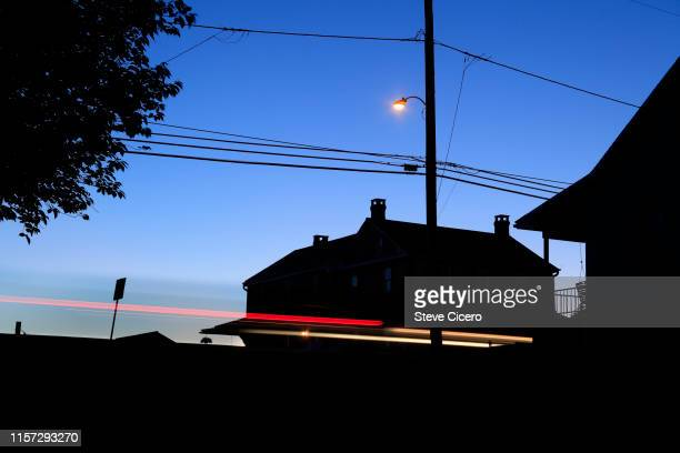 cars passing each other on rural road - moving past stock pictures, royalty-free photos & images