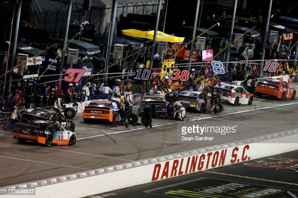 Cars pit during the Monster Energy NASCAR Cup Series Bojangles' Southern 500 at Darlington Raceway on September 01 2019 in Darlington South Carolina