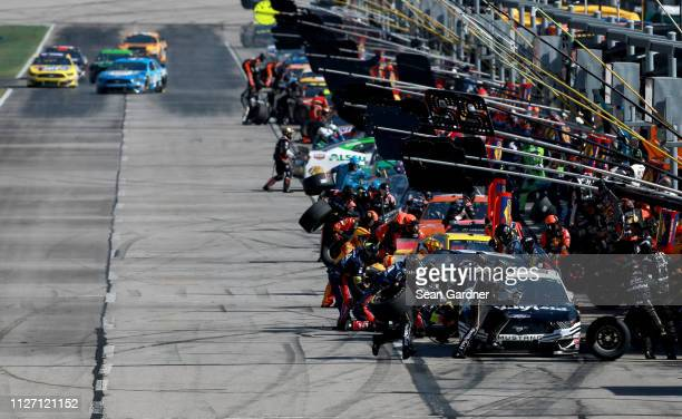 Cars pit during the Monster Energy NASCAR Cup Series Folds of Honor QuikTrip 500 at Atlanta Motor Speedway on February 24 2019 in Hampton Georgia