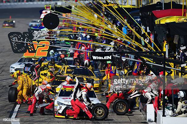 Cars pit during the NASCAR Sprint Cup Series SYLVANIA 300 at New Hampshire Motor Speedway on September 27 2015 in Loudon New Hampshire