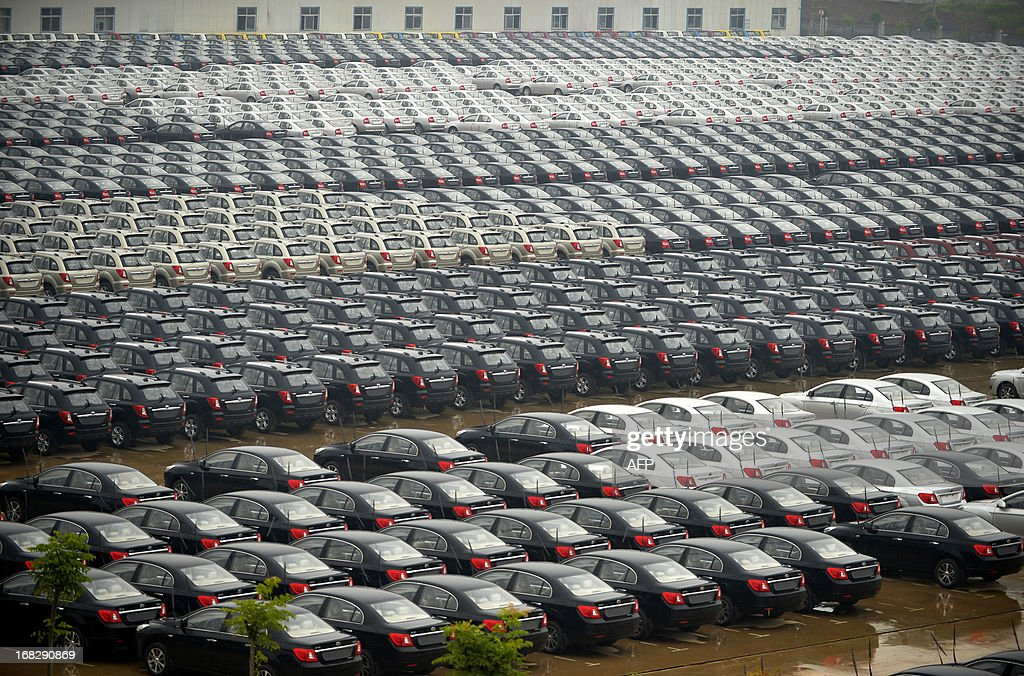 Cars produced by a Chinese private vehicle company are park on a parking lot close to a port on the Yangtze River in Wuhan, central China's Hubei province on May 8, 2013. China swung back to trade surplus in April after posting a rare deficit the previous month, official data showed on May 8, but analysts cautioned the better-than-expected figures may not reflect reality. CHINA