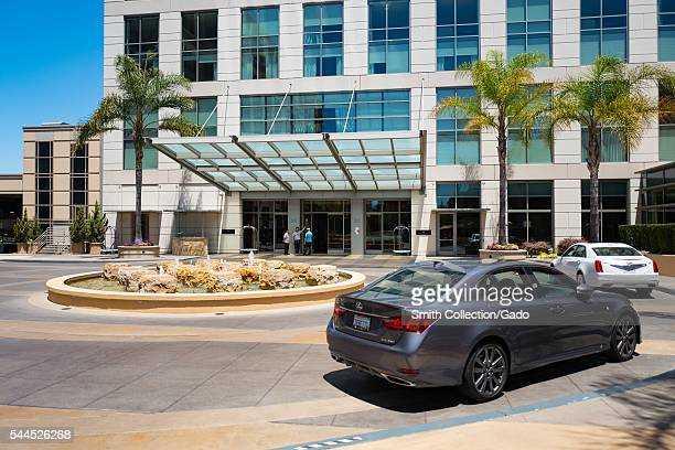 Cars pull into the entrance of the Four Seasons Hotel Silicon Valley on a sunny day East Palo Alto California 2016 The hotel is a popular location...