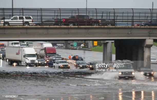 Cars pull to the side of the freeway of highway 69 North to get by the flood waters on September 19 2019 in Houston Texas Gov Greg Abbott has...