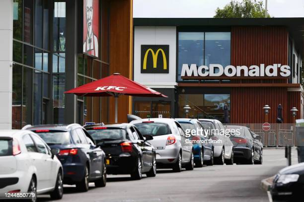 Cars queue at a Drive Thru McDonald's on June 04, 2020 in Stourbridge, England. The British government further relaxed Covid-19 quarantine measures...