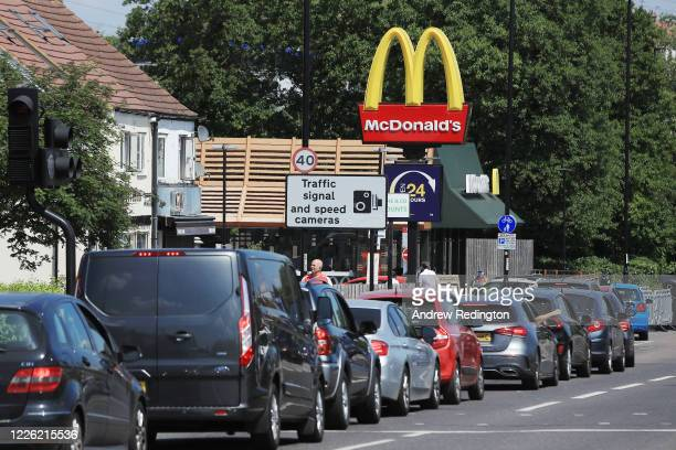 Cars queue at a Drive Thru McDonald's on May 21, 2020 in Sutton, England. The British government has started easing the lockdown it imposed two...