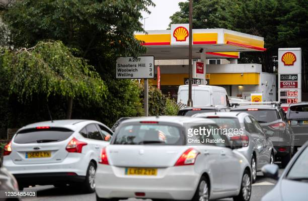 Cars queue for fuel at a Shell garage which doesnt have any unleaded fuel left on September 25, 2021 in Blackheath, London, United Kingdom. BP and...