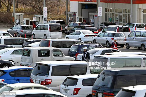 Cars queue for fuel at the gas station of the Chojahara Service Area after Tohoku Expressway is fully reopened on March 24 2011 in Osaki Miyagi Japan...