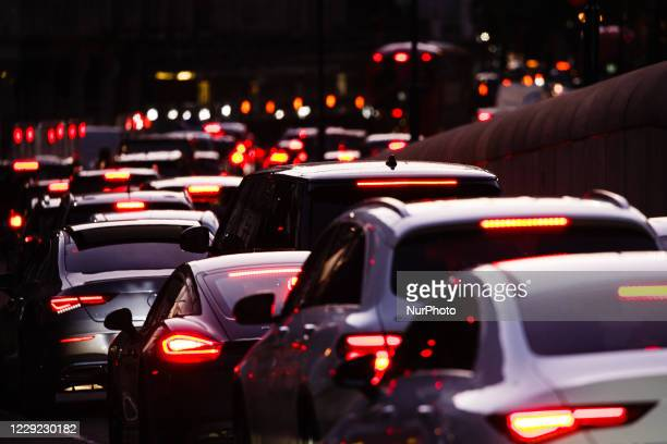 Cars queue in a long traffic jam on Knightsbridge in London, England, on October 22, 2020. Government plans to expand the London Congestion Charging...