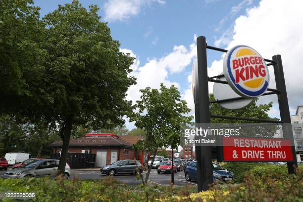 Cars queue near the sign for the Burger King drive-through in Havant, their first branch to reopen during coronavirus lockdown on May 01, 2020 in...