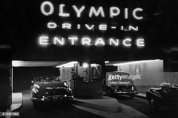 Cars queue up at the entrance to the Olympic Drive In in Hollywood