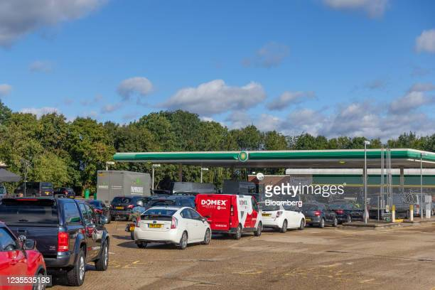 Cars queue up to use the fuel pumps at BP Plc petrol station near Guildford, U.K., on Monday, Sept. 27, 2021. The U.K. Government took emergency...