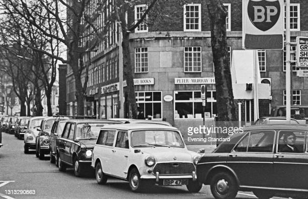 Cars queuing at a BP petrol station on Sloane Avenue, Kensington, London, during the oil crisis, UK, 7th December 1973.
