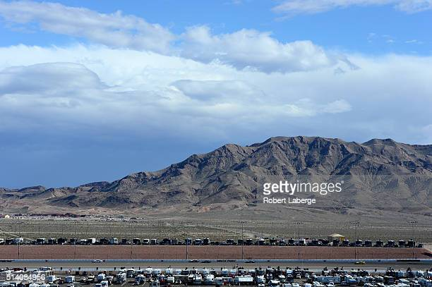 Cars race along the back stretch during the NASCAR Sprint Cup Series Kobalt 400 at Las Vegas Motor Speedway on March 6 2016 in Las Vegas Nevada