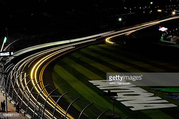 Cars race along the front stretch during the Rolex 24 at Daytona International Speedway on January 29, 2011 in Daytona Beach, Florida.