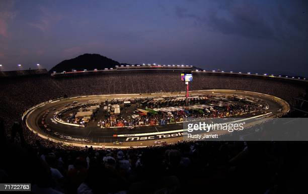 Cars race around the track as night falls during the NASCAR Nextel Cup Series Sharpie 500 on August 26 2006 at Bristol Motor Speedway in Bristol...