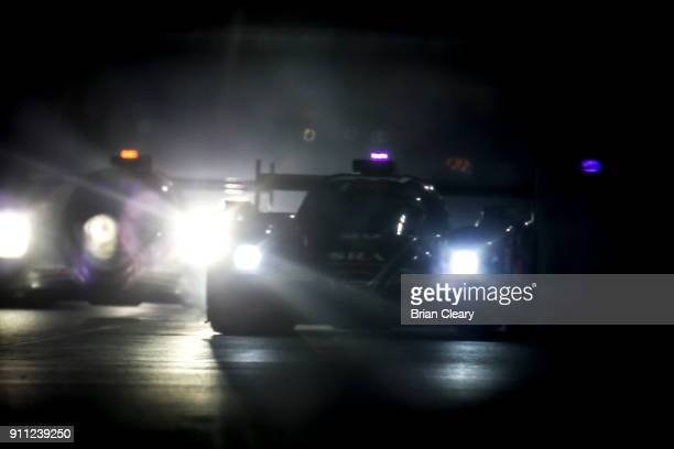 Cars race at night during the Rolex 24 at Daytona at Daytona International Speedway on January 27 2018 in Daytona Beach Florida