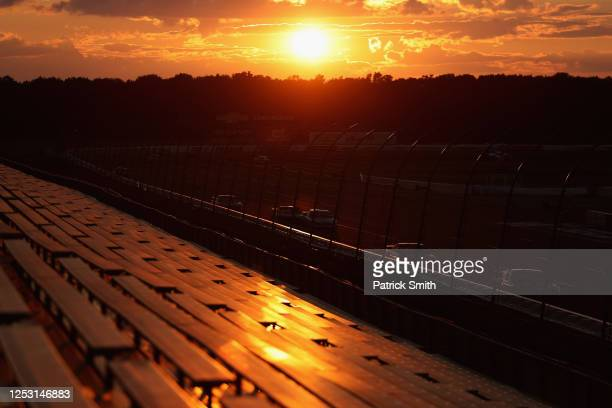 Cars race at sunset during the NASCAR Cup Series Pocono 350 at Pocono Raceway on June 28, 2020 in Long Pond, Pennsylvania.