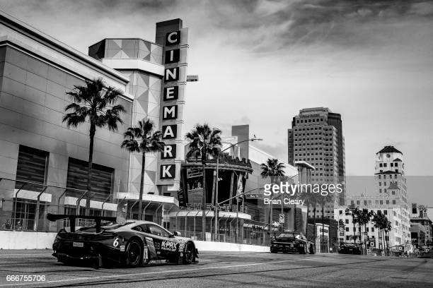 Cars race down Bay Sreet during the Pirelli World Challenge GT race at the Grand Prix at Long Beach on April 9 2017 in Long Beach California