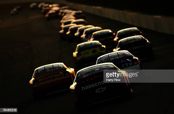 Cars race down the backstretch during the NASCAR Nextel Cup Series Sharp Aquos 500 at California Speedway on September 2, 2007 in Fontana, California.