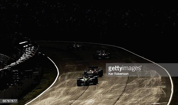 Cars race down the pit straight during the Feature Race of the British A1 Grand Prix of Nations at Brands Hatch on September 25 in Longfield, England.