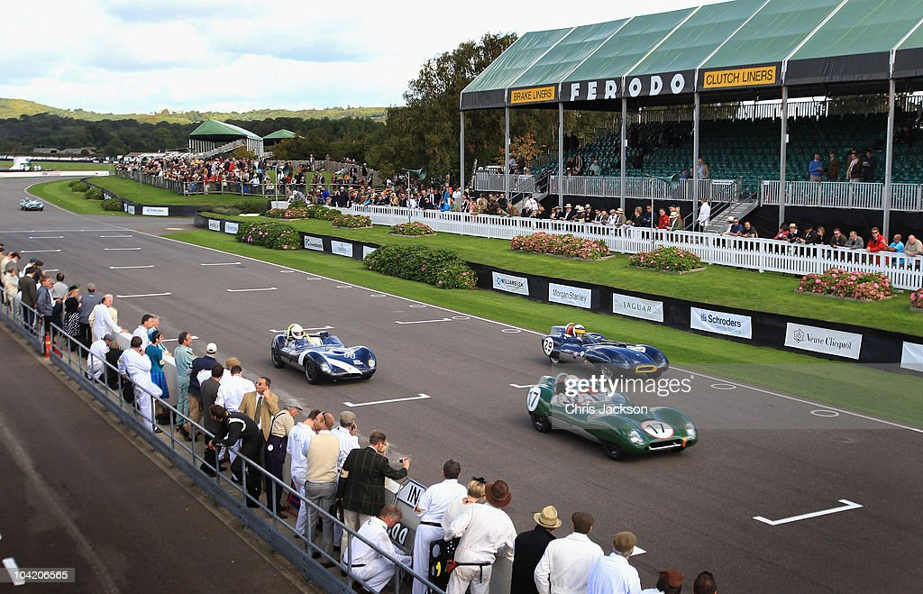 Cars race down the track during the Goodwood Revival 2010 at Goodwood on September 17, 2010 in Chichester, England. The event is based around a classic car race meeting and airshow but celebrates all things of a certain period.