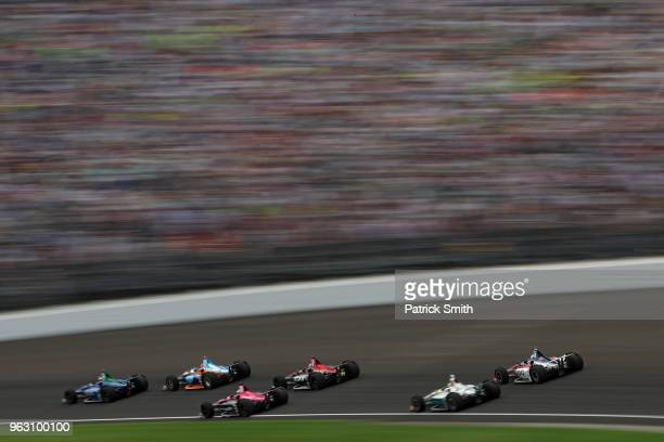 Cars race during the 102nd Indianapolis 500 at Indianapolis Motorspeedway on May 27 2018 in Indianapolis Indiana