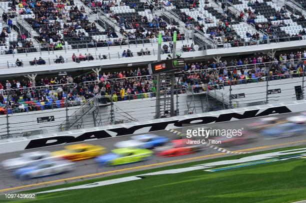 Cars race during the Monster Energy NASCAR Cup Series Advance Auto Parts Clash at Daytona International Speedway on February 10 2019 in Daytona Beach...