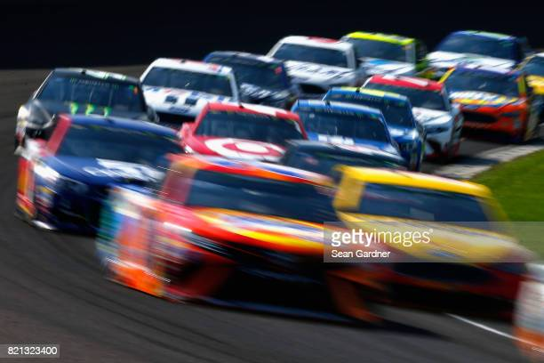 Cars race during the Monster Energy NASCAR Cup Series Brickyard 400 at Indianapolis Motorspeedway on July 23 2017 in Indianapolis Indiana