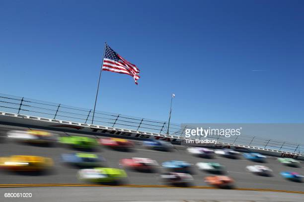 Cars race during the Monster Energy NASCAR Cup Series GEICO 500 at Talladega Superspeedway on May 7 2017 in Talladega Alabama