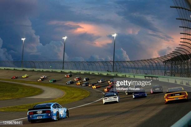 Cars race during the NASCAR Cup Series Dixie Vodka 400 at Homestead-Miami Speedway on June 14, 2020 in Homestead, Florida.