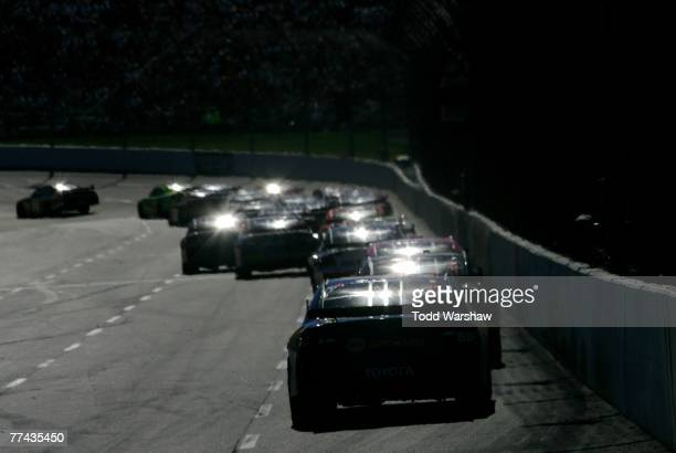 Cars race during the NASCAR Nextel Cup Series Subway 500 at Martinsville Speedway on October 21, 2007 in Martinsville, Virginia.