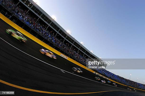 Cars race during the NASCAR Nextel Open on May 19 2007 at Lowe's Motor Speedway in Concord North Carolina