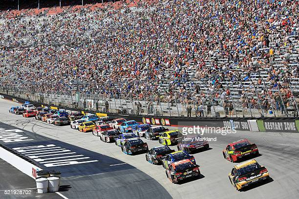 Cars race during the NASCAR Sprint Cup Series Food City 500 at Bristol Motor Speedway on April 17 2016 in Bristol Tennessee