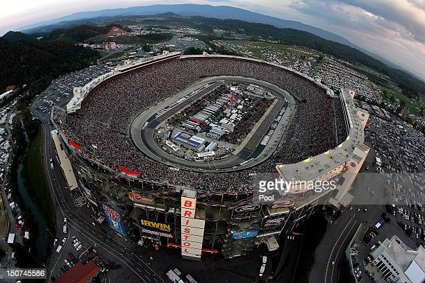 Cars race during the NASCAR Sprint Cup Series IRWIN Tools Night Race at Bristol Motor Speedway on August 25 2012 in Bristol Tennessee