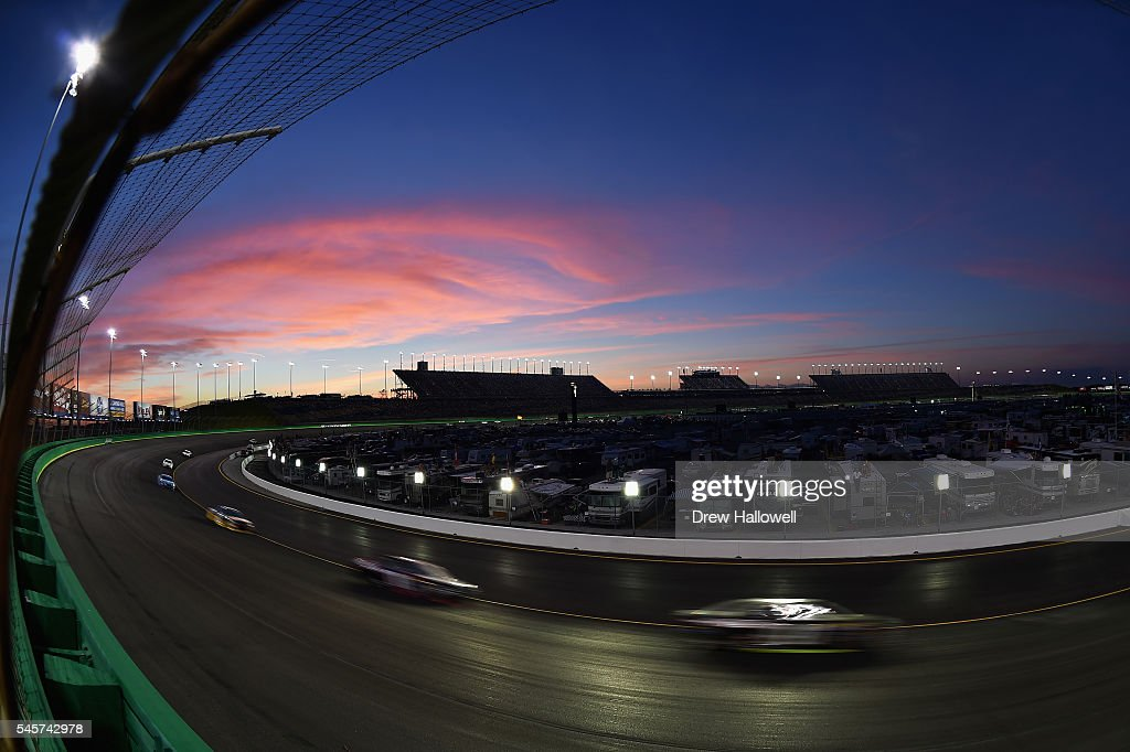Cars race during the NASCAR Sprint Cup Series Quaker State 400 at Kentucky Speedway on July 9, 2016 in Sparta, Kentucky.