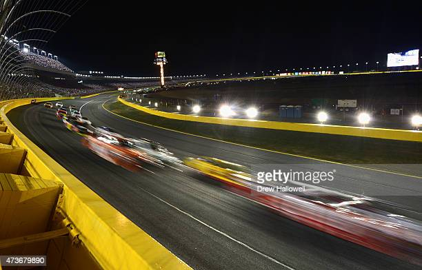 Cars race during the NASCAR Sprint Cup Series Sprint AllStar Race at Charlotte Motor Speedway on May 16 2015 in Charlotte North Carolina