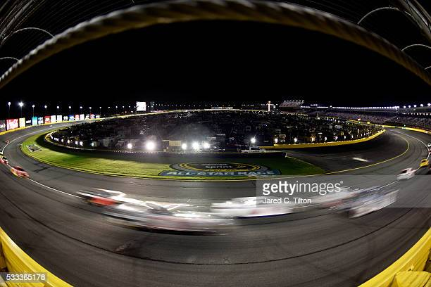 Cars race during the NASCAR Sprint Cup Series Sprint AllStar Race at Charlotte Motor Speedway on May 21 2016 in Charlotte North Carolina