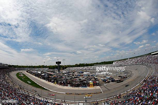 Cars race during the NASCAR Sprint Cup Series Toyota Owners 400 at Richmond International Raceway on April 26 2015 in Richmond Virginia