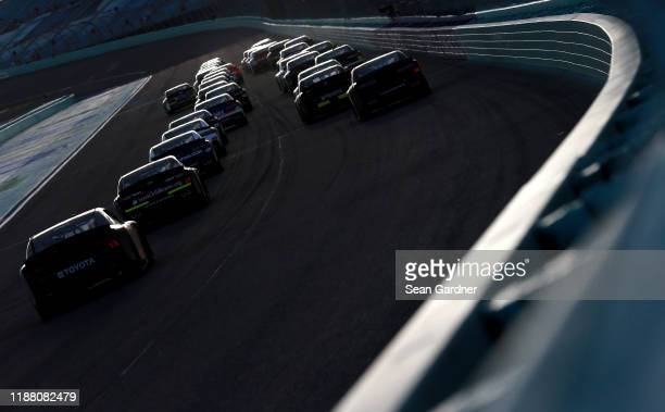 Cars race during the NASCAR Xfinity Series Ford EcoBoost 300 at HomesteadMiami Speedway on November 16 2019 in Homestead Florida
