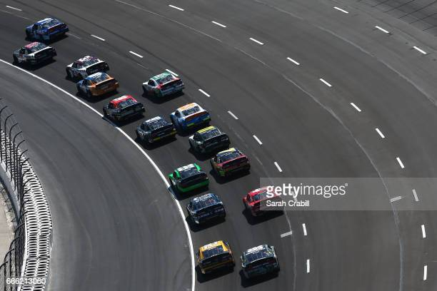 Cars race during the NASCAR XFINITY Series My Bariatric Solutions 300 at Texas Motor Speedway on April 8 2017 in Fort Worth Texas