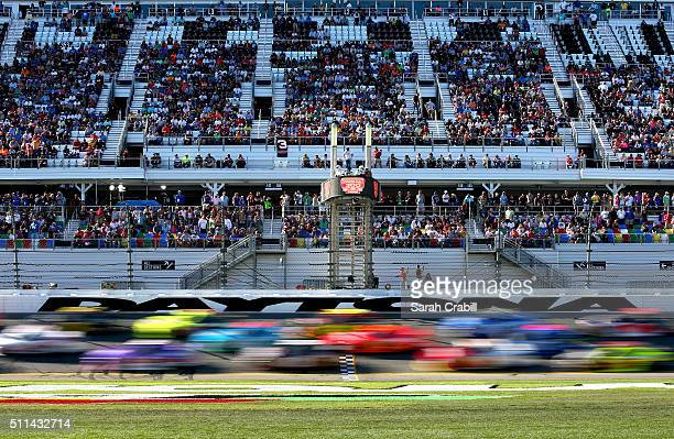 Cars race during the NASCAR XFINITY Series PowerShares QQQ 300 at Daytona International Speedway on February 20 2016 in Daytona Beach Florida