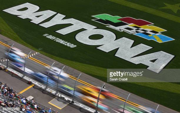 Cars race during the weather delayed Monster Energy NASCAR Cup Series Advance Auto Parts Clash at Daytona International Speedway on February 19 2017...