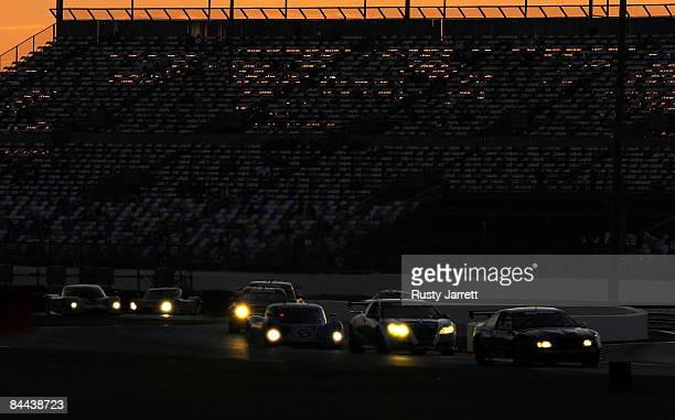 Cars race into darkness as the sun sets during the Rolex 24 at Daytona International Speedway on January 24, 2009 in Daytona Beach, Florida.