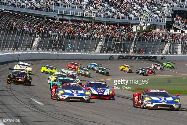 Cars race into turn one at the start of the Rolex 24 at Daytona at Daytona International Speedway on January 30, 2016 in Daytona Beach, Florida.