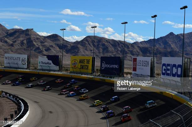 Cars race on the back stretch during the Monster Energy NASCAR Cup Series Pennzoil Oil 400 at Las Vegas Motor Speedway on March 3 2019 in Las Vegas...