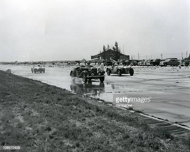 Cars race on the wet concrete runways during the 12 Hours of Sebring at Sebring International Raceway in the 1952.
