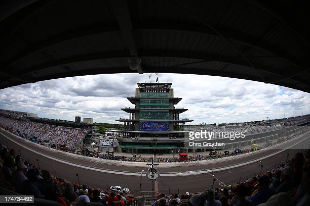 Cars race past the pagoda during the NASCAR Sprint Cup Series Samuel Deeds 400 At The Brickyard at Indianapolis Motor Speedway on July 28 2013 in...