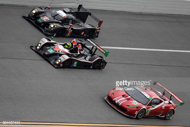 Cars race threewide in the banking during the Roar Before the 24 IMSA WeatherTech Series testing at Daytona International Speedway on January 10 2016...