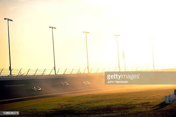 Cars race through turns three and four during The Rolex 24 at Daytona International Speedway on January 30, 2011 in Daytona Beach, Florida.