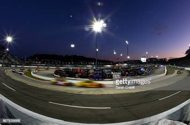 Cars race under the lights during the Monster Energy NASCAR Cup Series First Data 500 at Martinsville Speedway on October 29 2017 in Martinsville...